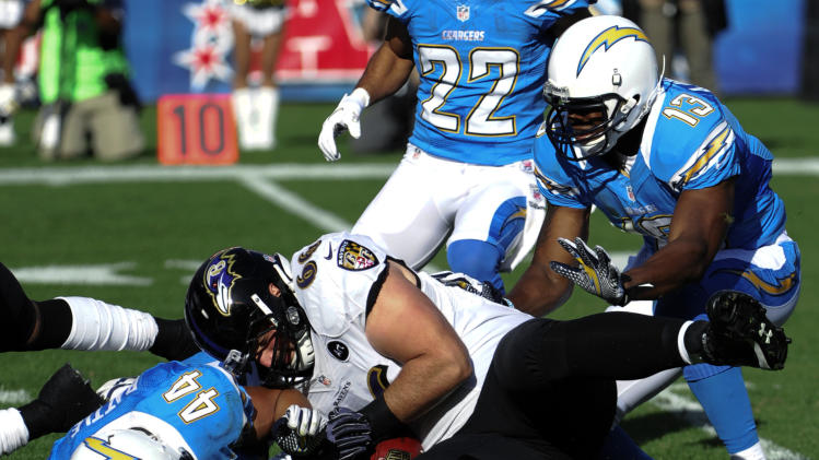 Baltimore Ravens guard Gino Gradkowski, center, recovers their own fumble away from San Diego Chargers' Jackie Battle, left, during the first half of an NFL football game, Sunday, Nov. 25, 2012, in San Diego. (AP Photo/Denis Poroy)