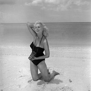 In this photograph taken in 1960 by photographer Bunny Yeager, Yeager poses for a self portrait in Naples, Fla. Yeager was a model who become a pin-up photographer in the 50's and 60's. (AP Photo/Copyright Bunny Yeager) NO SALES