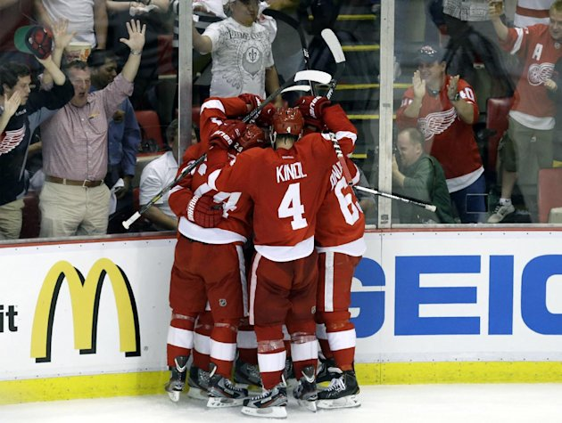 Detroit Red Wings players celebrate Detroit Red Wings center Gustav Nyquist's, of Sweden, goal against the Chicago Blackhawks during the second period of an NHL hockey Stanley Cup playoffs Western Con