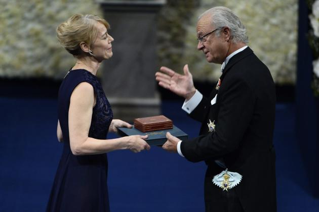 Daughter of Canadian author Alice Munro collects the Nobel Prize in Literature from Sweden's King Carl Gustaf during the 2013 Nobel Prize award ceremony in Stockholm