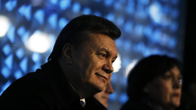 Ukrainian President Viktor Yanukovych watches the opening ceremony of the 2014 Winter Olympics, Friday, Feb. 7, 2014, in Sochi, Russia. (AP Photo/David Goldman, Pool)