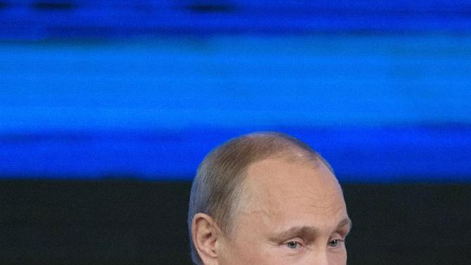 Russian President Vladimir Putin gestures as he speaks during his annual news conference in Moscow, Russia, Thursday, Dec. 18, 2014. Putin says Russia has sufficient currency reserves and that the ruble will recover. (AP Photo/Pavel Golovkin)