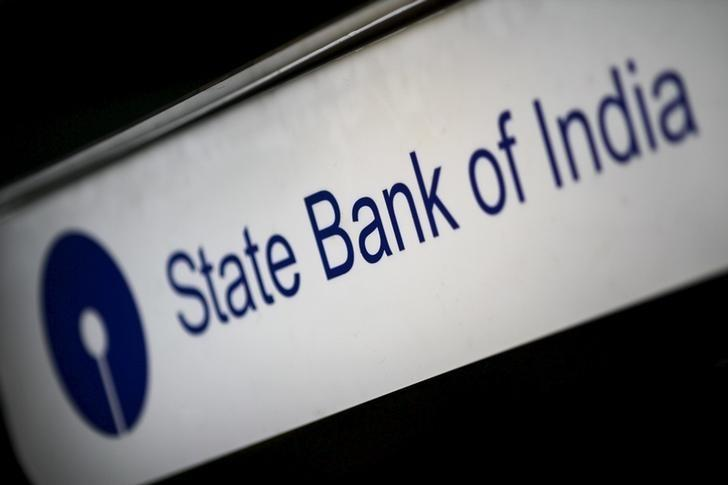SBI sees bad loan pressure persisting as profit sinks