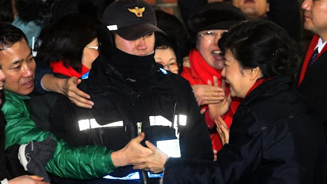 Dictator father looms over SKorea's new president