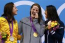 Gold medallist Missy Franklin (C) of the U.S. laughs with silver medallist Emily Seebohm (L) of Australia and bronze medallist Aya Terakawa (R) of Japan during the women's 100m backstroke victory ceremony at the London 2012 Olympic Games