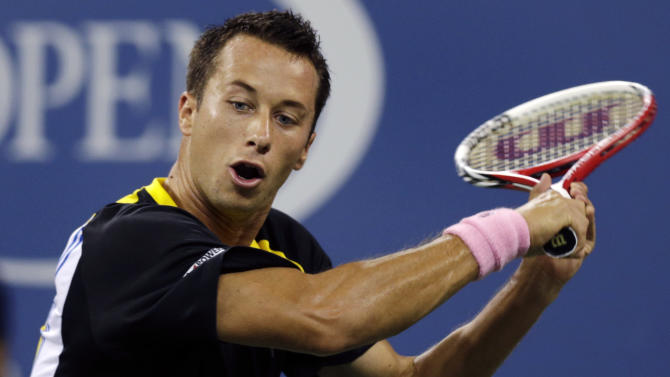 Philipp Kohlschreiber, of Germany, returns to John Isner in the third round of play at the U.S. Open tennis tournament, Sunday, Sept. 2, 2012, in New York. (AP Photo/Charles Krupa)