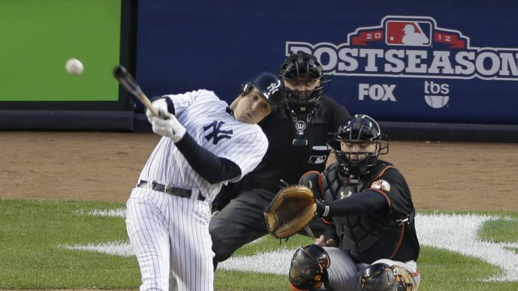 New York Yankees' Mark Teixeira hits a single against Baltimore Orioles pitcher Jason Hammel during the fifth inning in Game 5 of the American League division baseball series on Friday, Oct. 12, 2012, in New York. Orioles' catcher Matt Wieters and home plate umpire Mike Everitt watch the hit. (AP Photo/Peter Morgan)