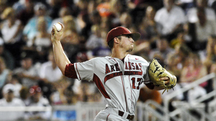 Arkansas pitcher Barrett Astin works against South Carolina in the seventh inning of an NCAA College World Series baseball game in Omaha, Neb., Monday, June 18, 2012. (AP Photo/Eric Francis)