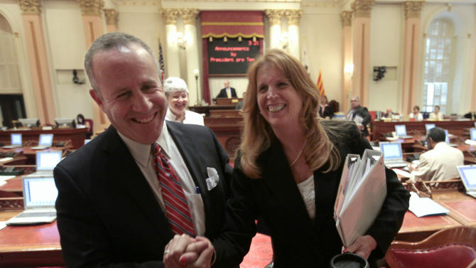 Senate President Pro Tem Darrell Steinberg, D-Sacramento, and Sen. Noreen Evans, D-Santa Rosa, smile as they leave the Senate after lawmakers approved the last of the budget-related bills at the Capitol in Sacramento, Calif. Wednesday, June 27, 2012. The Legislature approved 21 budget implementing bills to deal with a $15.7 billion budget deficit.(AP Photo/Rich Pedroncelli)