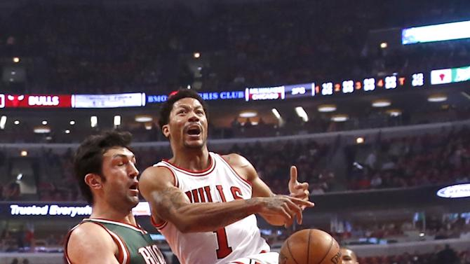 Chicago Bulls guard Derrick Rose (1) reacts after Milwaukee Bucks center Zaza Pachulia stripped the ball from Rose during the first half in Game 5 of the NBA basketball playoffs Monday, April 27, 2015, in Chicago. (AP Photo/Charles Rex Arbogast)