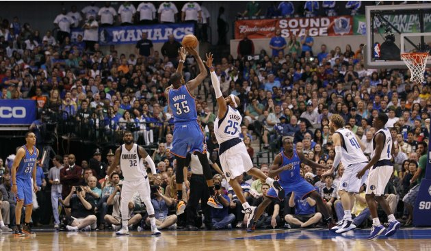 Thunder's Durant goes up for a shot against Mavericks' Carter during their NBA basketball game in Dallas