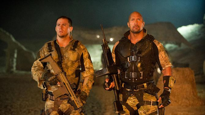 """FILE - In this publicity film image released by Paramount Pictures, Channing Tatum, left, and Dwayne Johnson are shown in a scene from """"G.I. Joe: Retaliation."""" In """"Retaliation,"""" Johnson takes over for Tatum, the star of 2009's """"G.I. Joe: The Rise of Cobra."""" Tatum plays a smaller role in the sequel as Johnson introduces moviegoers to Roadblock, a character from the G.I. Joe universe who's built like a tank but always served second in command. (AP Photo/Paramount Pictures, Jaimie Trueblood, File)"""