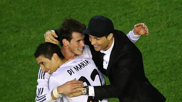 (From L) Real Madrid's Argentinian midfielder Angel di Maria, Welsh forward Gareth Bale and Portuguese forward Cristiano Ronaldo celebrate their victory at the end of the Copa del Rey final at the Mestalla stadium in Valencia on April 16, 2014