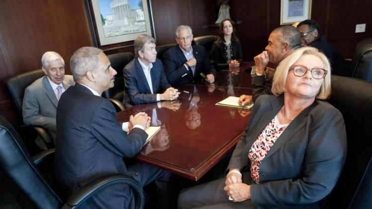 U.S. Attorney General Holder attends a meeting at the U.S. Attorney's office in St. Louis, Missouri