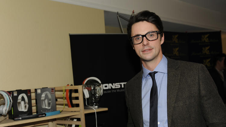 Actor Matthew Goode holds Inspiration headphones by Monster Products at the Fender Music lodge during the Sundance Film Festival on Monday, Jan. 21, 2013, in Park City, Utah. (Photo by Jack Dempsey/Invision for Fender/AP Images)