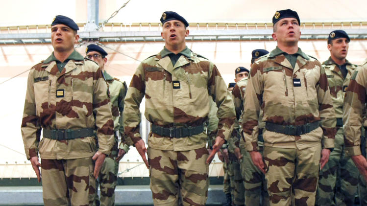 French soldiers sing the national anthem during a ceremony with French Defense Minister Jean-Yves Le Drian, before their departure to Mali, at Miramas Military base, southern France, Friday, Jan. 25, 2013. (AP Photo/Claude Paris)