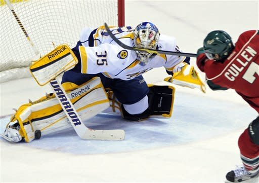 Fisher's 2 late goals help Predators stun Wild 5-4