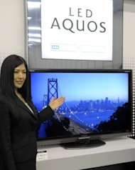 This file photo shows a Sharp&#39;s LCD TV display, LED AQUOS LC-60LX1, being presented at the company&#39;s Tokyo headquarters, in 2009. The century-old consumer electronics giant suffered a bloodletting this month with its Tokyo-traded shares diving to near 40-year lows after it reported huge quarterly losses and warned of more red ink to come
