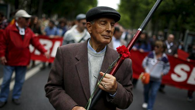 A man walks during a march marking the Carnation Revolution's 41st anniversary in Lisbon