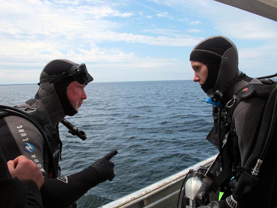 Michel L'Hour, left, director of France's Department of Underwater Archaeological Research, talks with colleague Olivia Hulot before diving to the site of what may be the fabled Griffin shipwreck, Saturday, June 15, 2013 in northern Lake Michigan. (AP Photo/John Flesher)