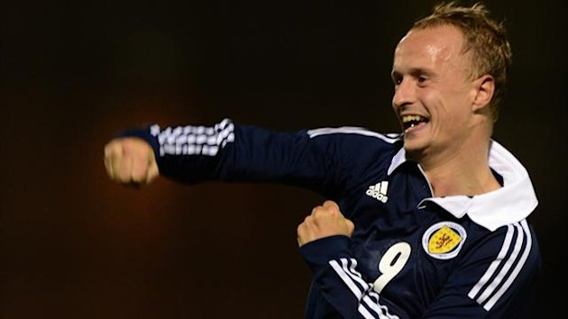 Scotland's Leigh Griffiths celebrates scoring (PA Photos)