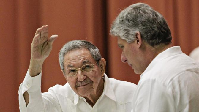 Cuba's President Raul Castro gestures beside first vice-president Miguel Diaz Canel, after delivering a speech to members of the National Assembly in Havana