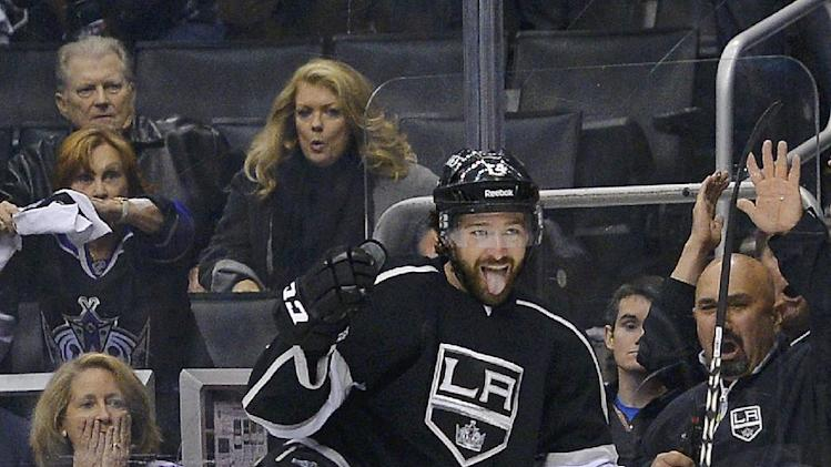 Los Angeles Kings right wing Justin Williams celebrates after scoring a goal against the San Jose Sharks during the second period in Game 7 of the Western Conference semifinals in the NHL hockey Stanley Cup playoffs, Tuesday, May 28, 2013, in Los Angeles. (AP Photo/Mark J. Terrill)