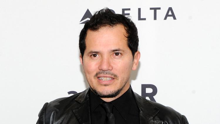 "FILE - This Feb. 6, 2013 file photo shows actor John Leguizamo at amfAR's New York gala in New York. Leguizamo lends his voice to the character Alex in the new film ""Walking with Dinosaurs."" (Photo by Evan Agostini/Invision/AP, File)"