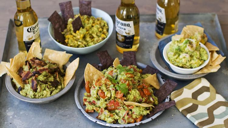 In this image taken on January 7, 2013, sweet heat bacon guacamole, left, chipotle corn guacamole, top, shrimp and mango guacamole, right, and roasted fresh salsa guacamole, front center, are shown served in bowls in Concord, N.H.  (AP Photo/Matthew Mead)