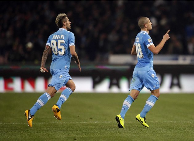 Napoli's Gokhan Inler celebrates after scoring against Juventus during their Italian Serie A soccer match at the San Paolo Stadium in Naples