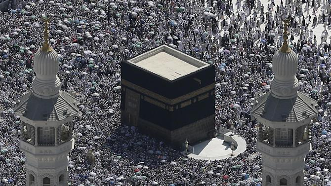 This aerial image made from a helicopter shows tens of thousands of Muslim pilgrims moving around the Kaaba, the black cube seen at center, inside the Grand Mosque, during the annual Hajj in the Saudi holy city of  Mecca, Saudi Arabia, Saturday, Oct. 27, 2012. (AP Photo/Hassan Ammar)