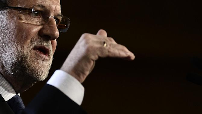 Spain's Prime Minister Mariano Rajoy speaks during a meeting in Barcelona, Spain, Saturday, Jan. 31, 2015. (AP Photo/Manu Fernandez)