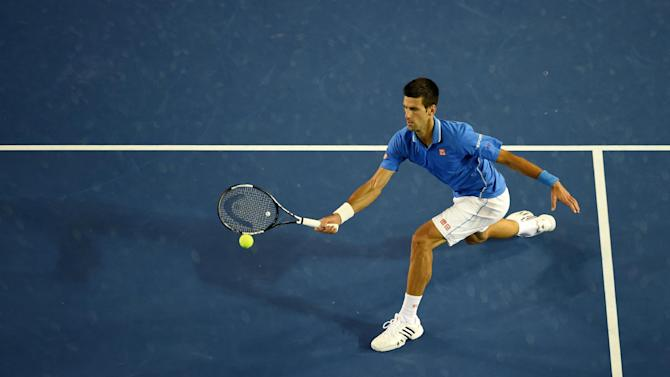 Serbia's Novak Djokovic plays a shot during his men's singles final match against Britain's Andy Murray on day fourteen of the 2015 Australian Open tennis tournament in Melbourne on February 1, 2015
