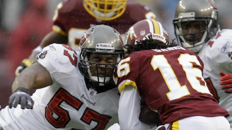 In this Dec. 12, 2010 file photo, Tampa Bay Buccaneers linebacker Adam Hayward (57) tackles Washington Redskins wide receiver Brandon Banks (16) during the first half of an NFL football game in Landover, Md. The Washington Redskins announced the signing of free agent special teams standout Adam Hayward, Wednesday, March 12, 2014