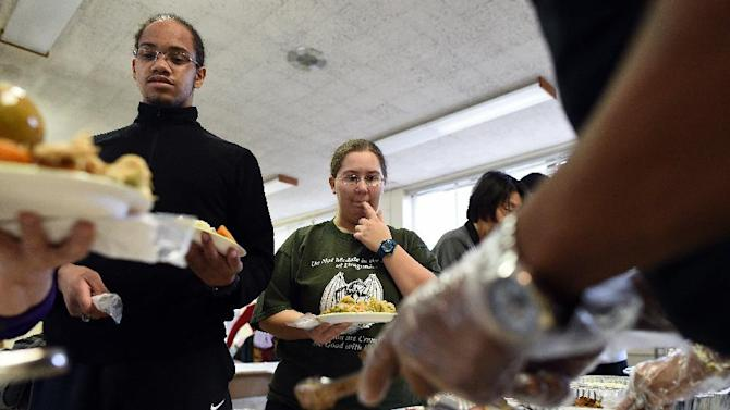 People are served with a Thanksgiving meal at a church in Ferguson, Missouri, on November 27, 2014