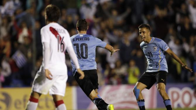 Uruguay's Pereiro celebrates with his team mate after scoring a goal against Peru during their South American Under-20 Championship soccer match in Montevideo