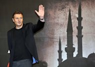 "US actor Liam Neeson poses for a photo before a press conference to promote his film ""Taken 2"" in Seoul in September 2012. Neeson's return as ex-CIA agent Bryan Mills in the movie easily topped the North American box office on its opening weekend, industry estimates showed Sunday"