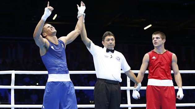 Britain's Anthony Ogogo (L) wins against the Ukraine's Ievgen Khytrov in their Men's Middle (75kg) Round of 16 boxing match during the London 2012 Olympic Games (Reuters)