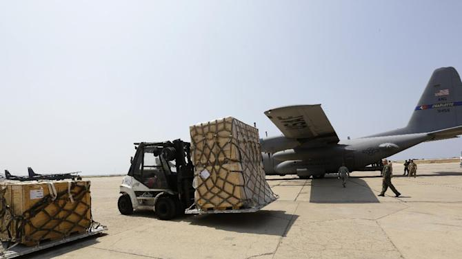 A forklift moves a shipment of weapons that was delivered by a US air force plane on August 29, 2014 at a Lebanese military base at Beirut International Airport