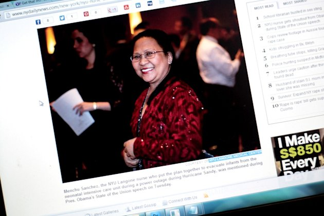 <p>Filipina nurse Menchu Sanchez's photo is seen on a New York-based news site. Sanchez was lauded by U.S. President Barack Obama for her heroism during the power outage on the onslaught of Hurricane Sandy.</p>