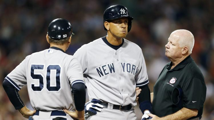 FILE - In this Aug. 18, 2013 file photo, New York Yankees' Alex Rodriguez, center, is tended to by a trainer at first base after being hit by a pitch in the second inning of a baseball game against the Boston Red Sox in Boston. Rodriguez got hit by a fastball from Boston starter Ryan Dempster. (AP Photo/Michael Dwyer)