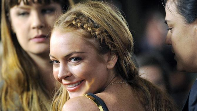 """FILE - This April 11, 2013 file photo shows actress Lindsay Lohan, a cast member in """"Scary Movie V,"""" at the premiere of the film in Los Angeles. Lohan says this time it's going to be different. In an interview that aired Sunday Aug. 18, 2013, with Oprah Winfrey, the troubled actress declared that this, her sixth stint in rehab, has put her on a path of recovery. Lohan said she's in """"a different head space"""" now and vowed to stay clear-headed and focused in the future. (Photo by Chris Pizzello/Invision/AP, File)"""