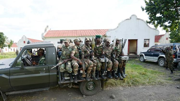 M23 rebels sit on the back of a truck on June 1, 2013 in Rumangabo military camp, 40 km from Goma