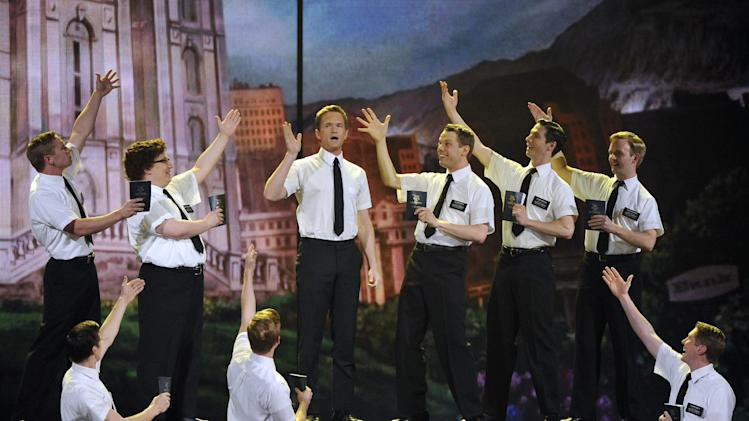 "Host Neil Patrick Harris performs with the cast of ""The Book of Mormon"" at the 66th Annual Tony Awards on Sunday June 10, 2012, in New York. (Photo by Charles Sykes /Invision/AP)"