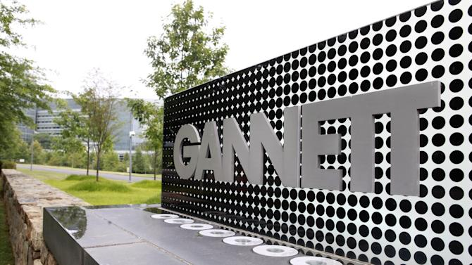 FILE - In this July 14, 2010 file photo, the sign for Gannett headquarters is displayed in McLean, Va. Gannett said Thursday, June 13, 2013, it reached a deal to buy TV station owner Belo for about $1.5 billion in cash, significantly boosting its presence in broadcasting. (AP Photo/Jacquelyn Martin, file)