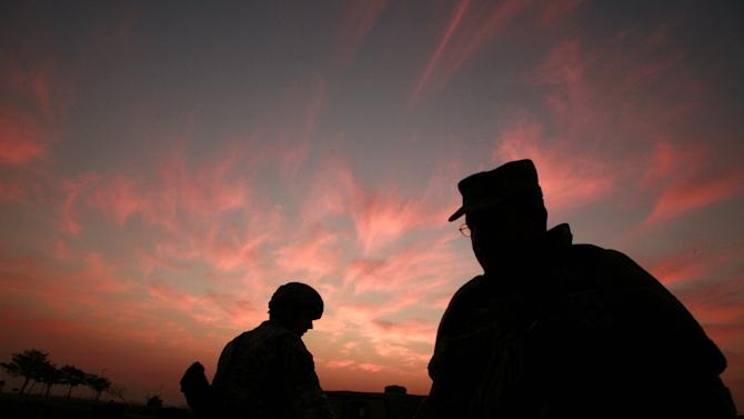 FILE - In this Jan. 25, 2007 file photo, the sun sets at a US military base Camp Liberty in Baghdad, Iraq. The White House is planning to keep up to 10,000 troops in Iraq next year, despite opposition not only from Iraqis but also key Democratic Party allies who demand that President Barack Obama bring home the U.S. military as he promised as a candidate. (AP Photo/Maya Alleruzzo, File)