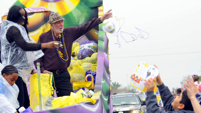 IMAGE DISTRIBUTED FOR FOX SEARCHLIGHT - Lowell Landis, cast member of the Academy Award nominated picture Beasts of the Southern Wild, throws beads in the Argus parade on Mardi Gras on Tuesday, Feb. 12, 2013 in Metairie, La. (Photo by Cheryl Gerber/Invision for Fox Searchlight Pictures/AP Images)