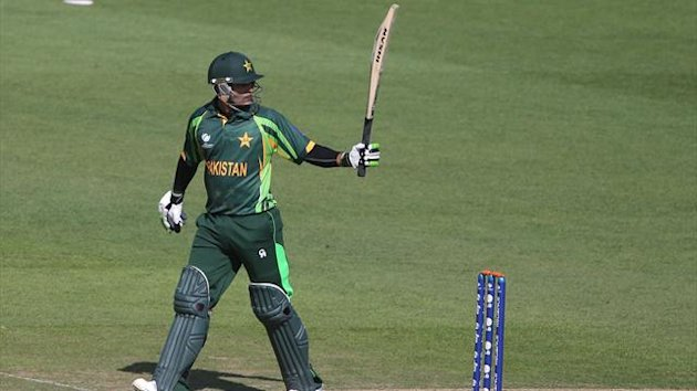 Pakistan's Muhammad Hafeez raises his bat (PA Photos)