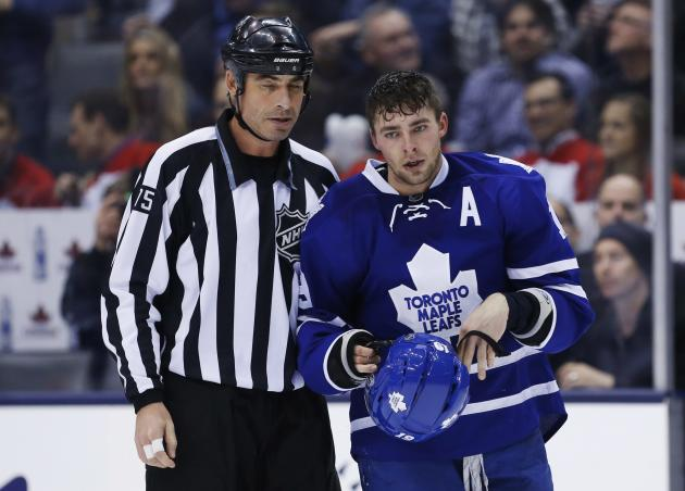 Toronto Maple Leafs' Joffrey Lupul picks up his helmet after receiving a penalty against Los Angeles Kings' Viatcheslav Voynov during second period NHL hockey action in Toronto Wednesday, Dec.