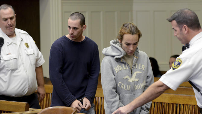 Ryan J. Barry, second from left, and Ashley Cyr, second from right, are led into Brockton, Mass., Superior Court for arraignment Friday, Oct. 11, 2013, on charges of manslaughter in the death of their 5-month-old daughter Mya Berry, by giving her a bottle of formula with heroin in September 2011. The couple pleaded not guilty. (AP Photo/Boston Herald, Ted Fitzgerald, Pool)